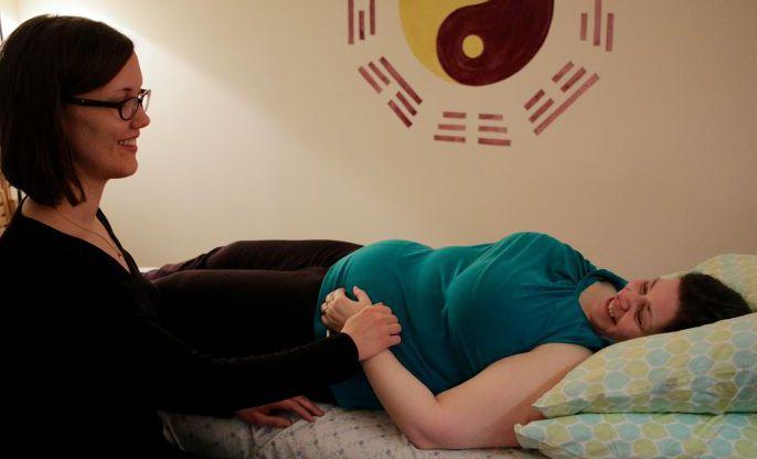 Lynn Palmgren taking pulse of patient