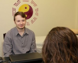 Nick Arestopoulos interviewing patient at Oak Park Acupuncture Center